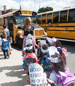 08/30/18  Wesley Bunnell | Staff  Lincoln Elementary School Kindergarten Teacher Kayla Montanaro, R, looks over her list as she helps students find their bus home after the first day of school on Thursday.