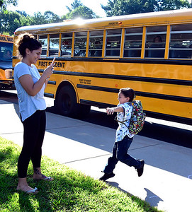 8/30/2018 Mike Orazzi | Staff Jayden Marrero runs toward his mom Jessica after getting off the bus on the first day at the Mt. View School on Thursday morning.