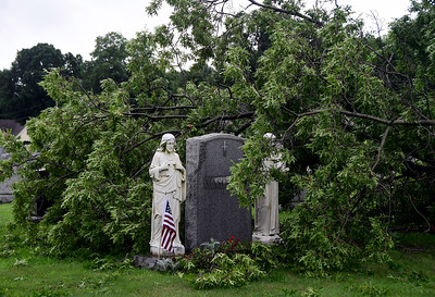 8/4/2018 Mike Orazzi | Staff A large tree damaged during an overnight storm at the St. Joseph Cemetery in Bristol Saturday.