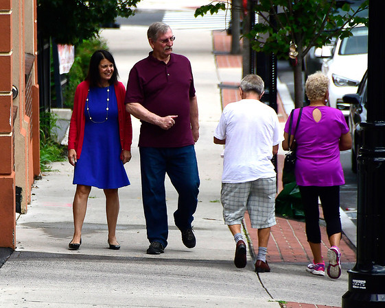 8/4/2018 Mike Orazzi   Staff Connecticut 5th Congressional District democratic candidate Mary Glassman walks with Lucian Pawlak in New Britain Saturday.