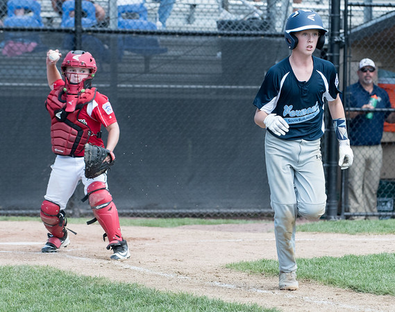 08/06/18 Wesley Bunnell | Staff Rhode Island defeated Vermont 10-0 in a 2018 East Regional Little League game in Bristol on Monday afternoon. Rhode Island catcher Anthony Colucci (17) prepares to throw down to first.