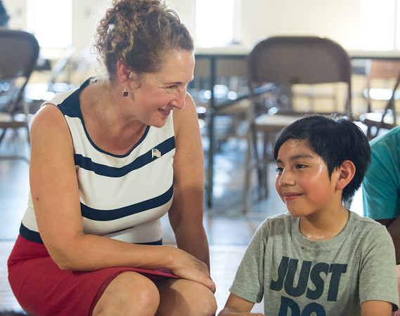 08/06/18 Wesley Bunnell | Staff Congresswoman Elizabeth Esty (CT-5) met with members of End Hunger CT to discuss the importance of summer nutrition for children at OIC on Monday morning. Elizabeth Esty sits and speaks with OIC student Leon Cabrera, age 10.