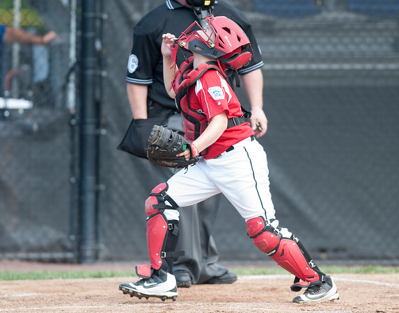 08/06/18 Wesley Bunnell | Staff Rhode Island defeated Vermont 10-0 in a 2018 East Regional Little League game in Bristol on Monday afternoon. Rhode Island catcher Anthony Colucci (17) tracks a pop up behind home plate.