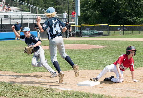 08/06/18 Wesley Bunnell | Staff Rhode Island defeated Vermont 10-0 in a 2018 East Regional Little League game in Bristol on Monday afternoon. Vermont pitcher Kevin Dowling (24) celebrates after catching a line drive back to the mound and throwing to first baseman Nick Kelly (14) to double off the Rhode Island runner.