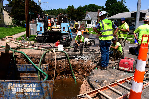 8/6/2018 Mike Orazzi | Staff Bristol Water Department while fixing a water main break on Park Street in Bristol Monday afternoon.