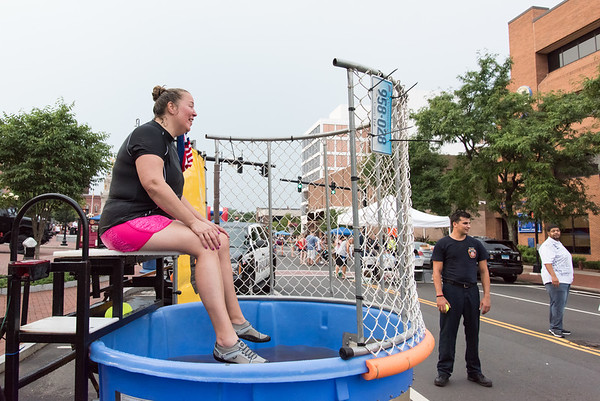 08/07/18 Wesley Bunnell | Staff New Britain Police held their annual National Night Out 2018 on Tuesday evening in a blocked off Central Park area. New Britain CSO Julie Swan sits at the dunk tank waiting for the next thrower.