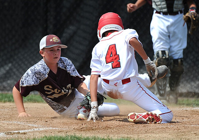 8/7/2018 Mike Orazzi | Staff Maine's Jeremiah Chessie (7) covers home plate as Fairfield American's Eli Balkan scores at Breen Field in Bristol Tuesday.