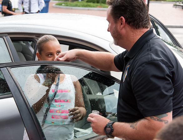 08/07/18 Wesley Bunnell | Staff New Britain Police held their annual National Night Out 2018 on Tuesday evening in a blocked off Central Park area. Lyanna Pagan, age 10, dusts for fingerprints on a police vehicle with the help of Det. Brian Shea.