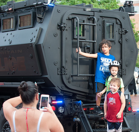 08/07/18 Wesley Bunnell | Staff New Britain Police held their annual National Night Out 2018 on Tuesday evening in a blocked off Central Park area. Kim Bartman takes a photo of her sons and nephew on a police armored vehicle during the event. Braydon McLellan, age 7, top, Brady McLellan, age 6 middle, ,and Ryan Michaud, age 5.