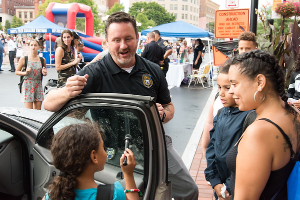 08/07/18 Wesley Bunnell | Staff New Britain Police held their annual National Night Out 2018 on Tuesday evening in a blocked off Central Park area. Yeralis Velez, age 7, dusts for fingerprints on a police vehicle with the help of Det. Brian Shea as Samuel Rivera, age 9, and mom Yeraisa Otero look on.