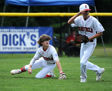 8/7/2018 Mike Orazzi | Staff Fairfield American's Pierce Cowles (8) and Aiden Gouley (27) at Breen Field in Bristol Tuesday.