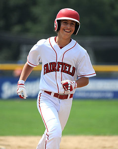 8/7/2018 Mike Orazzi | Staff Fairfield American's Dustin Walters (14) after his home run at Breen Field in Bristol Tuesday.