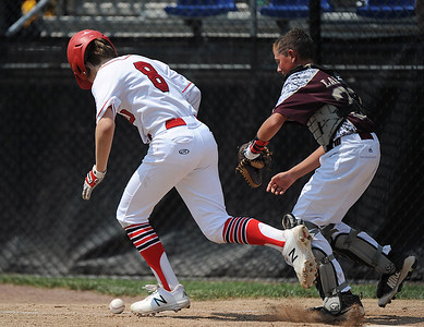 8/7/2018 Mike Orazzi | Staff Fairfield American's Pierce Cowles (8) and Maine's Henry Lausier (26) at Breen Field in Bristol Tuesday.