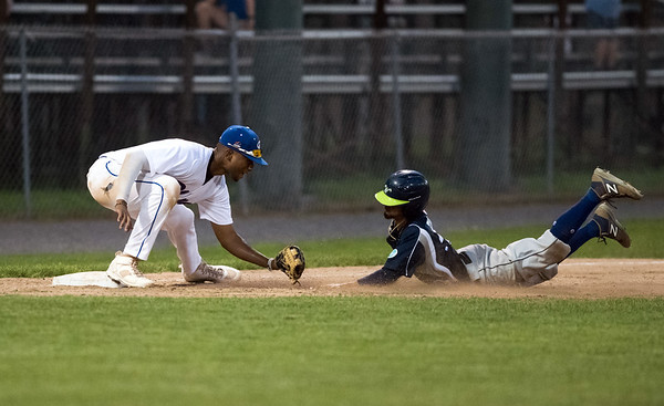 08/08/18 Wesley Bunnell | Staff Bristol Blues third baseman Justyn-Henry Malloy (10) applies the tag for an out on the Worcester Bravehearts runner after a great throw by right fielder Peyton Stephens (31) during a FCBL semi final playoff game on Wednesday night at Muzzy Field.