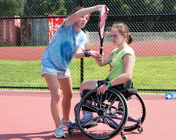 08/08/18 Wesley Bunnell | Staff Volunteer Cecily Meehan from Farmington reviews Catherine Faherty's, from Norwell Mass, forehand with her during The Hospital for Special Care's Ivan Lendl Adaptive Sports Camp this week at Berlin High School. The camp is held every summer for youth with physical disabilities ages 6-19.