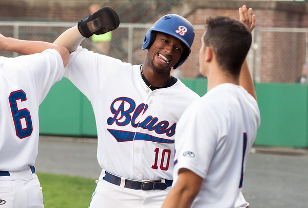 08/08/18 Wesley Bunnell | Staff Bristol Blues third baseman Justyn-Henry Malloy (10) high fives teammates after scoring a run early in a FCBL semi final playoff game vs the Worcester Bravehearts on Wednesday night at Muzzy Field.