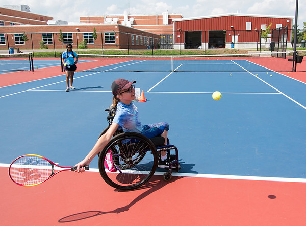 08/08/18 Wesley Bunnell | Staff Helen Newman from North Granby practices her forehand on the tennis courts with the help of volunteer Dwaritha Ramesh at Berlin High School on Wednesday afternoon as part of The Hospital for Special Care's Ivan Lendl Adaptive Sports Camp The camp is held every summer for youth with physical disabilities ages 6-19.