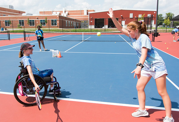 08/08/18 Wesley Bunnell | Staff Helen Newman from North Granby practices her forehand on the tennis courts with the help of volunteer Cecily Meehan from Farmington at Berlin High School on Wednesday afternoon as part of The Hospital for Special Care's Ivan Lendl Adaptive Sports Camp The camp is held every summer for youth with physical disabilities ages 6-19.