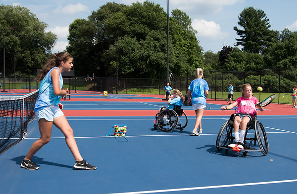08/08/18 Wesley Bunnell | Staff Camper Brooke Sargent from Hamilton Mass practices her forehand with the help of volunteer Rafaela Kottou during The Hospital for Special Care's Ivan Lendl Adaptive Sports Camp on Wednesday afternoon at Berlin High School. The camp is held every summer for youth with physical disabilities ages 6-19.