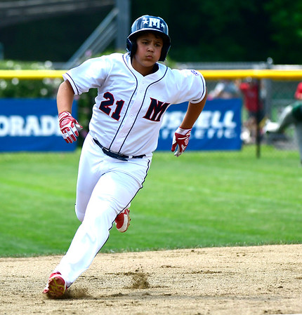 8/8/2018 Mike Orazzi | Staff Mid Island New York Little League's Derek Mendez (21) on his way to third base at Breen Field in Bristol.