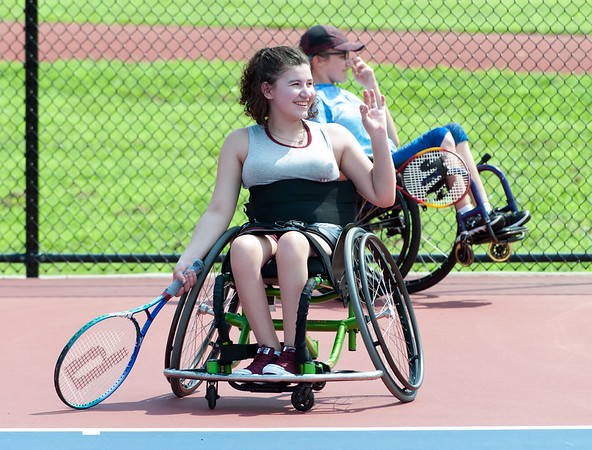 08/08/18 Wesley Bunnell | Staff Hennessy Hernandez from Naugatuck smiles as she waves to a friend during tennis practice at The Hospital for Special Care's Ivan Lendl Adaptive Sports Camp this week at Berlin High School. The camp is held every summer for youth with physical disabilities ages 6-19.