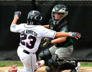 8/8/2018 Mike Orazzi | Staff Middletown New Jersey Little League'sJoey Wall (8)  tags out Mid Island New York's  John Calabrese (23) at Breen Field in Bristol.