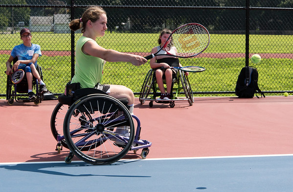 08/08/18 Wesley Bunnell | Staff Camper Catherine Faherty from Norwell Mass practices her backhand during The Hospital for Special Care's Ivan Lendl Adaptive Sports Camp on Wednesday afternoon at Berlin High School. The camp is held every summer for youth with physical disabilities ages 6-19.