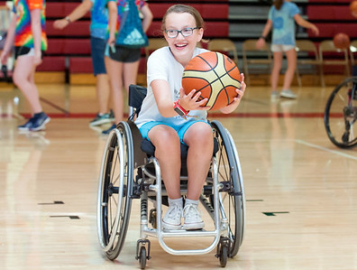 08/08/18  Wesley Bunnell | Staff  Lauren Sargent from Hamilton Mass practices her basketball dribbling at the gymnasium at Berlin High School on Wednesday afternoon during The Hospital for Special Care's Ivan Lendl Adaptive Sports Camp. The camp is held every summer for youth with physical disabilities ages 6-19.