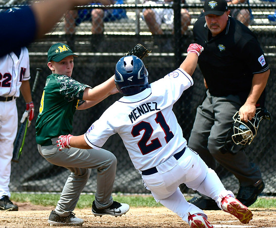 8/8/2018 Mike Orazzi | Staff Middletown New Jersey Little League's Reid Tully (3) tag out Mid Island New York's Derek Mendez (21) at Breen Field in Bristol.