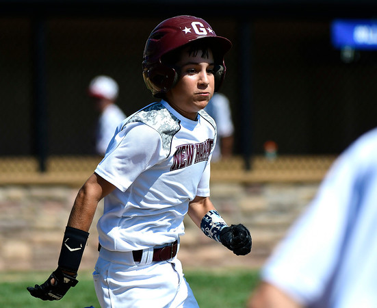 8/9/2018 Mike Orazzi | Staff Goffstown Junior Baseball Little League's James Baggs (5) Thursday at Breen Field in Bristol.