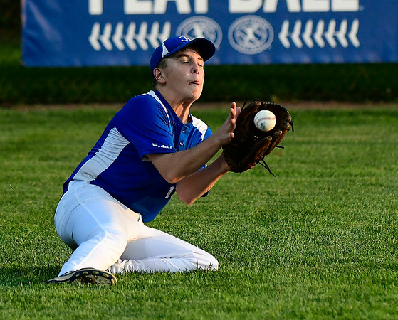 8/9/2018 Mike Orazzi | Staff Keystone Little League's Gavin Burnell (14) makes a diving catch at Breen Field in Bristol during Thursday evenings 2018 Eastern Regional Little League Baseball Tournament.