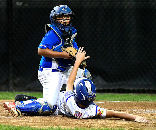 8/9/2018 Mike Orazzi | Staff Keystone Little League's Gardner Fravel (10) tags out Maryland's Lukas Loring (24) at Breen Field in Bristol during Thursday evenings 2018 Eastern Regional Little League Baseball Tournament.