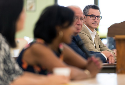 08/09/18  Wesley Bunnell | Staff  The New Britain Senior Center held a Meet The Candidates Meet & Greet for candidates of Connecticut's 5th Congressional District on Thursday afternoon. Republican Manny Santos looks down the table as Democrat Jahana Hayes answers questions from the attendees.