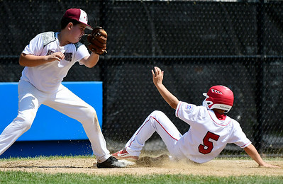 8/9/2018 Mike Orazzi | Staff Fairfield American Little League's Jude Gussen (5) and Goffstown Junior Baseball Little League's Cam Hujsak (22) Thursday at Breen Field in Bristol.