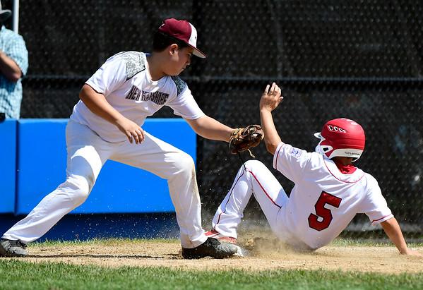 8/9/2018 Mike Orazzi | Staff Fairfield American Little League's Jude Gussen (5) and Goffstown Junior Baseball Little League's Cam Hujsak (22) Thursday at Breen Field in Bristol.
