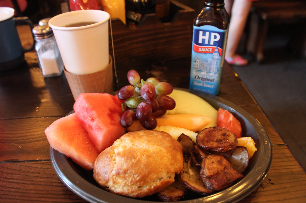 Breakfast at Leaky Cauldron at Universal Orlando, including tea, a breakfast pie, potatoes, and fruit