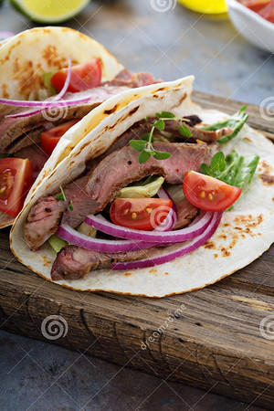 http://www.dreamstime.com/royalty-free-stock-images-steak-tacos-sliced-meet-salad-tomato-salsa-cutting-board-image75540189