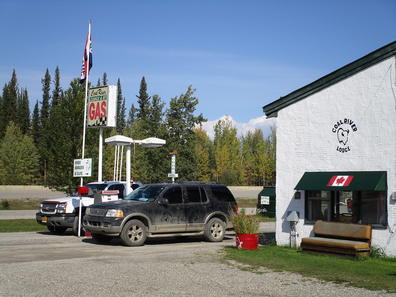Day 5 - LHS BC to Whitehorse YT, 401 miles<br /> <br /> This is a shot of a typical gas station along the Alaska Highway.  One pump.  The station is also a roadhouse with a small restaurant, general store, showers, camping area, etc.  It's basically a one stop shop - a one pump chump, if you will - for travelers; but the catch is that they are spaced out infrequently, are often closed down in the off season, and are only open during daytime hours so there is no 24 hour gas.  For that reason it pays to plan the route carefully, again, using 'The Milepost', and to carry some spare fuel in case you screw up the planning.