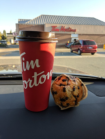 Day 2<br /> <br /> Tim Hortons.  Love that coffee.  Meredith gets a muffin.  I'm a chocolate chip cookie man, myself.