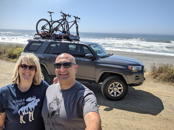 Day 1- Eureka CA to Battle Ground WA, 443 miles<br /> <br /> Heading out!  We stopped for the first pic of the trip near Orick CA on US 101 to get a shot of both of us and the truck with the Pacific Ocean in the background.