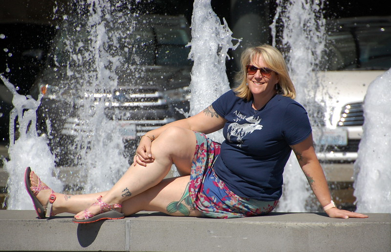 Day 2<br /> <br /> Mer poses at the fountain in front of the Space Needle.