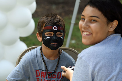 A happy teenage mutant ninja turtle and the artist who created the turtle-faced hero.