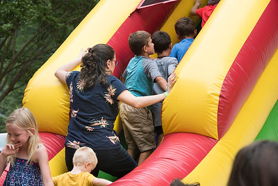 Lined up a half-dozen in a row to ride the inflatable slide.
