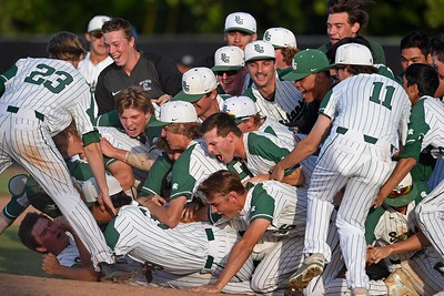 The De La Salle Spartans celebrate after the final out against Heritage in the seventh inning of the NCS Division I baseball championship at Diablo Valley College in Pleasant Hill, Calif., on Saturday, May 25, 2019. De La Salle defeated Heritage 10-1 to win it's 4th straight NCS title and 28th game in a row. (Jose Carlos Fajardo/Bay Area News Group)