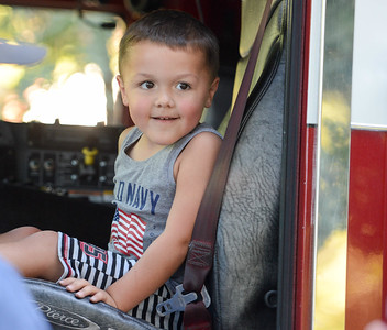 Kahlin Pete, 3, sits in a fire truck during National Night Out at Capre Acres on Tuesday in Chico. (Matt Bates -- Enterprise-Record)