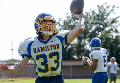 Hamilton High's C.J. Whisenand fires a pass during practice Friday in Hamilton City. (Matt Bates -- Enterprise-Record)