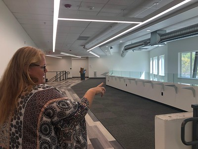 Mary Cox shows the new study center on the second floor of the new high school building at CORE Butte Charter's campus Tuesday, August 6, 2019. (Natalie Hanson -- Enterprise-Record)