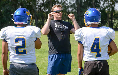 Hamilton High head coach Matt Jarvis speaks to  players before practice on Friday in Hamilton City. (Matt Bates -- Enterprise-Record)