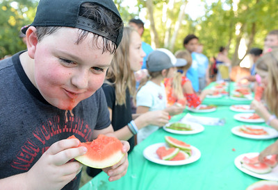 Zayne Eller, 8, competes in the watermelon eating contest during National Night Out at Capre Acres on Tuesday in Chico. (Matt Bates -- Enterprise-Record)