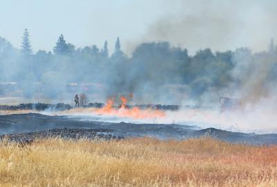 Firefighters battle a vegetation fire Tuesday near Bruce Road in Chico. (Matt Bates -- Enterprise-Record)